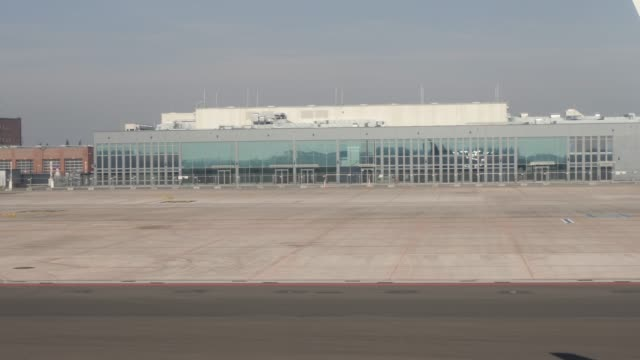 pan across airport buildings at schoenefeld airport berlin germany - brandenburg state stock videos & royalty-free footage