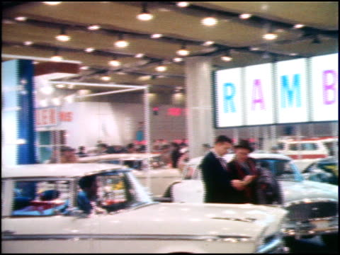 RIGHT across AMC display at the 1959 Chicago Auto Show white Ambassador in foreground special Ambassador Monticello in turntable on background also...