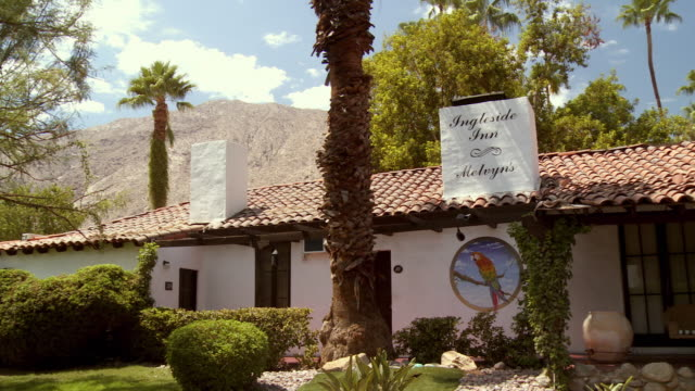 pan across california boutique hotel built in spanish colonial revival architectural style - inn stock videos and b-roll footage