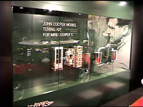 right across giant mini sign and mini cooper car mounted to the wall / ws john cooper works tuning kit display pan right to front end of mini cooper... - 自動車ブランド mini点の映像素材/bロール
