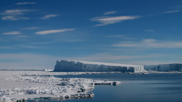 ws pan across iceberg, antarctica - south pole stock videos and b-roll footage