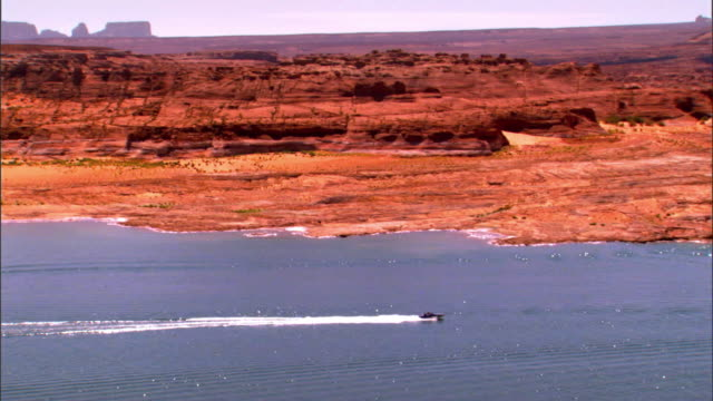 ws pan across lake powell in glen canyon national recreation area with speed boats and house boats on the lake / page, arizona, usa - lake powell stock videos & royalty-free footage