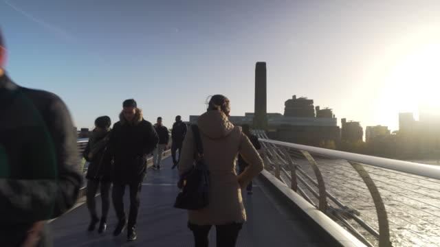 pov across millennium bridge towards tate modern - london millennium footbridge stock videos and b-roll footage