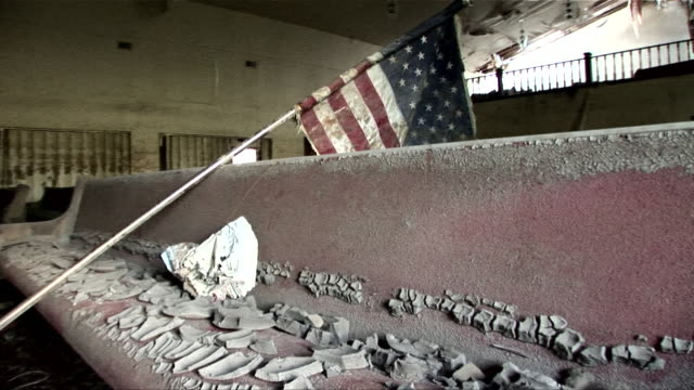 ms pan across mud-caked pew in ninth ward church with dirty american flag laying across it/ new orleans, louisiana - hurricane katrina stock videos and b-roll footage
