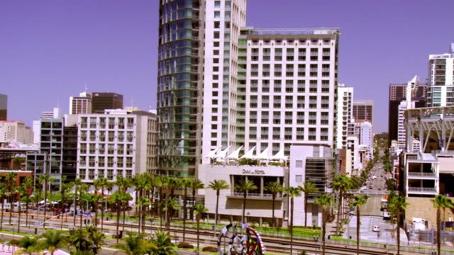 WS PAN across Promenade Park and Gaslamp Quarter to Petco Park baseball stadium  / San Diego, California, USA