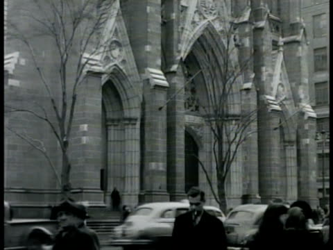 ws ext st patrick's cathedral w/ traffic moving downtown on 5th avenue people walking sidewalk fg roman catholic archdiocese parish church religion... - st. patrick's cathedral manhattan stock videos and b-roll footage