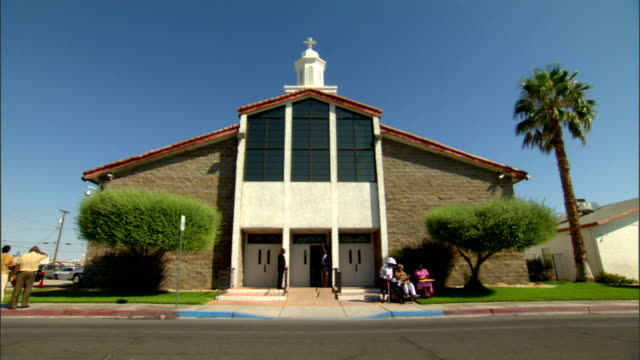 ws front of church building some unidentifiable african american people family standing amp sitting in front nv las vegas nevada - las vegas crosses stock-videos und b-roll-filmmaterial