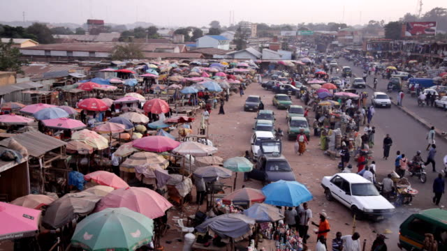 ws pan across street market nigeria is home to nearly 200 million people which has earned it the name giant of africa it is an oil rich country which... - jos nigeria stock videos & royalty-free footage