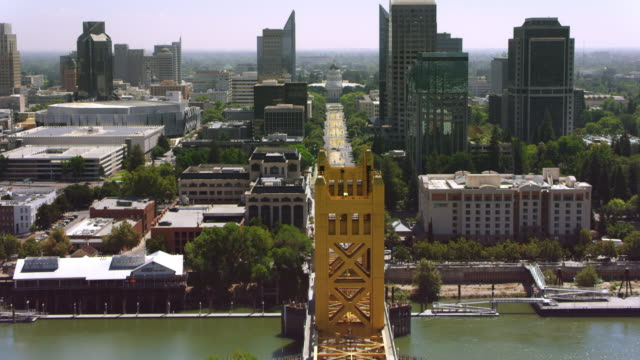 AERIAL Across the Tower Bridge towards The California State Capitol in Sacramento, CA