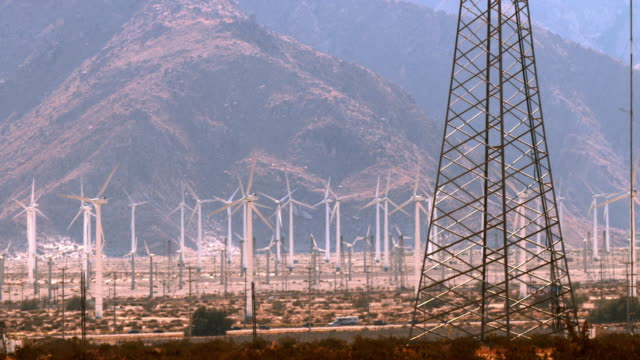 PAN across traffic on interstate 10 and large scale wind farm on San Gorgonio Mountain Pass / Palm Springs, California, USA