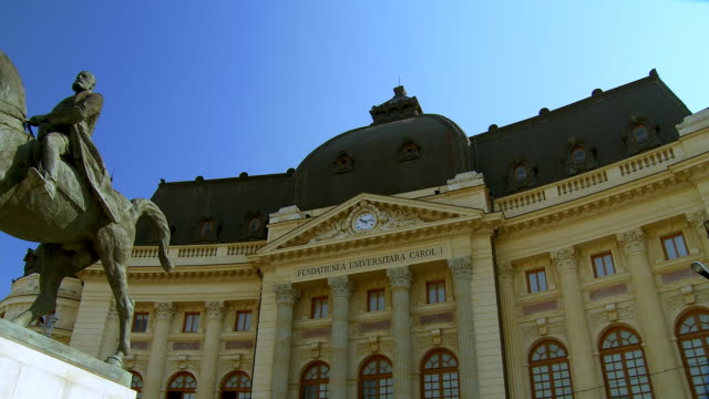 WS PAN Across university foundation building and statue of romanian king carl i on horseback/ Bucharest, Romania
