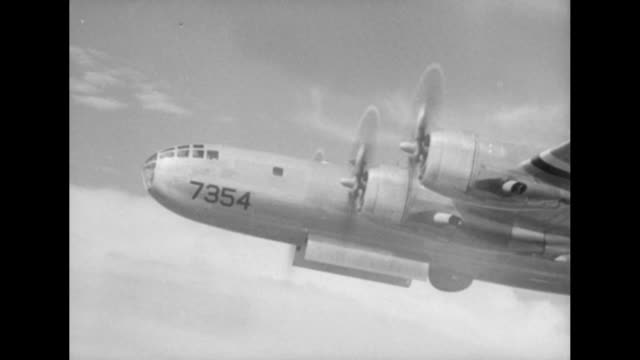 initial blast wilson cloud and emerging mushroom cloud up into sky / front half of b29 dave's dream with bomb bay doors open / inside bombardier... - b rolle stock-videos und b-roll-filmmaterial