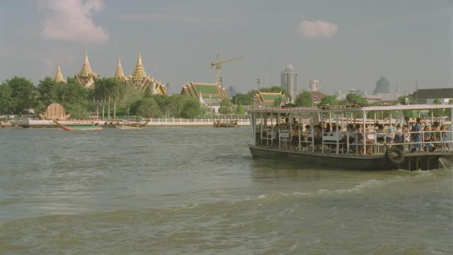 d/x across water to bangkok, thailand (1997); boat traffic by - bangkok stock videos & royalty-free footage