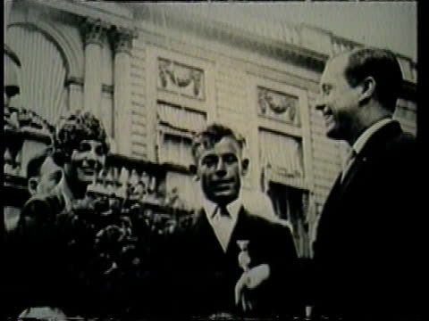 acting mayor joseph mckee presents a bouquet of flowers to amelia earhart. - award stock videos & royalty-free footage