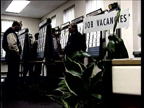 action against age discrimination; lib england: graphic sequence middle-aged man looking at vacancies in job centre - vacancyサイン点の映像素材/bロール