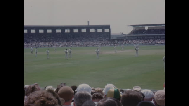 action from the 1st test match between england and the west indies at old trafford in june 1966 including: a view of the old trafford pavilion and a... - cricket video stock e b–roll