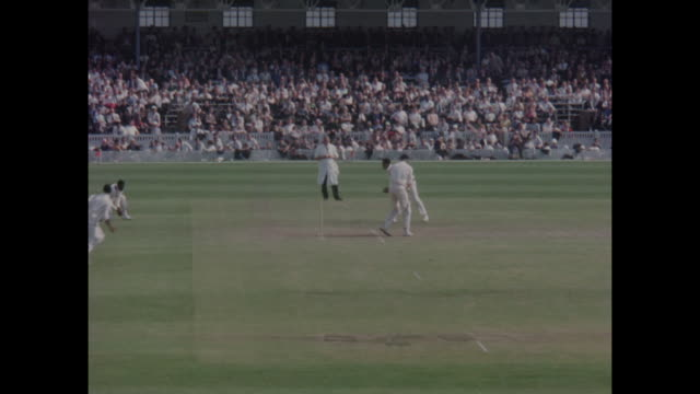 Action from the 1st Test Match between England and the West Indies at Old Trafford in June 1966 including England batsman MJK Smith walking out to...