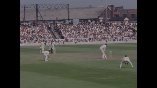 Action from the 1st Test Match between England and the West Indies at Old Trafford in June 1966 including England batsman Colin Cowdrey walking out...