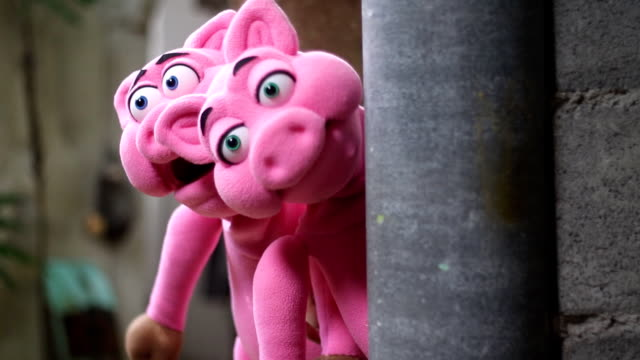 action of pink pig hand puppet