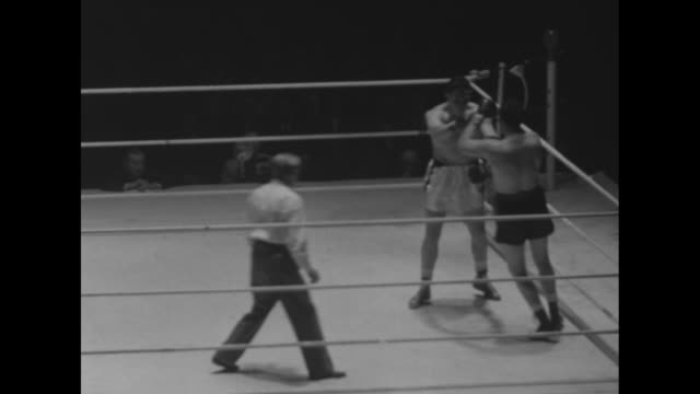 Action shot of fight between James Parker Canadian heavyweight and Johnny Arthur South African heavyweight in Maple Leaf Gardens / marquee and...