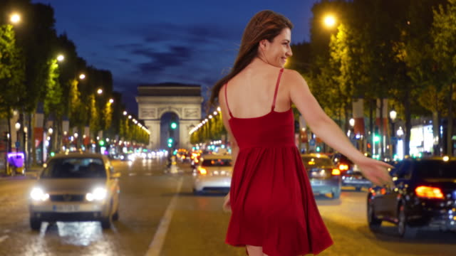 active good-looking caucasian female dancing in street in paris, france - red dress stock videos & royalty-free footage