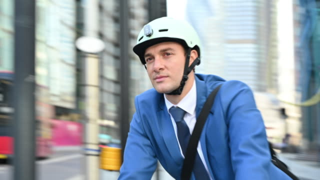 active male executive in early 30s cycling in city of london - double decker bus stock videos & royalty-free footage