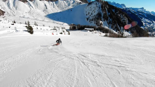 active man enjoying a sunny day on ski slopes - downhill skiing stock videos & royalty-free footage