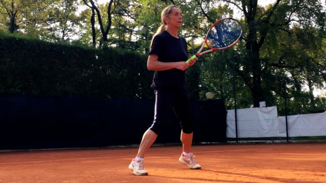 active mature woman playing tennis - racket stock videos and b-roll footage