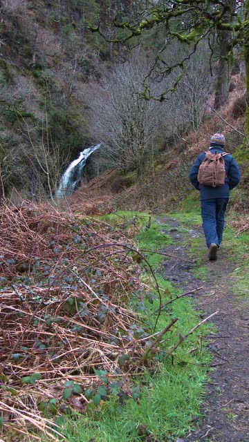 active retired man walking near a waterfall - johnfscott stock videos & royalty-free footage