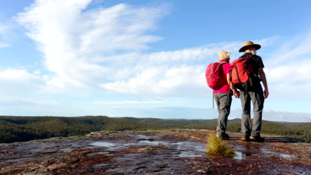 active senior couple hiking - mountain range stock videos & royalty-free footage