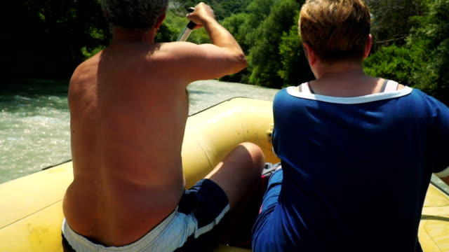 active senior couple kayaking on the river - senior couple stock videos & royalty-free footage