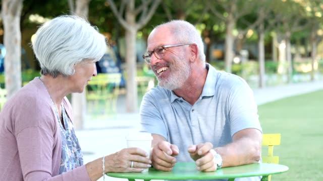 stockvideo's en b-roll-footage met actieve senior paar delen een lach - jong van hart