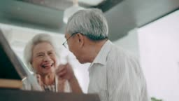 Active senior couple with piano hobbies