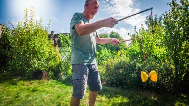 active senior juggling diabolo - juggling stock videos & royalty-free footage
