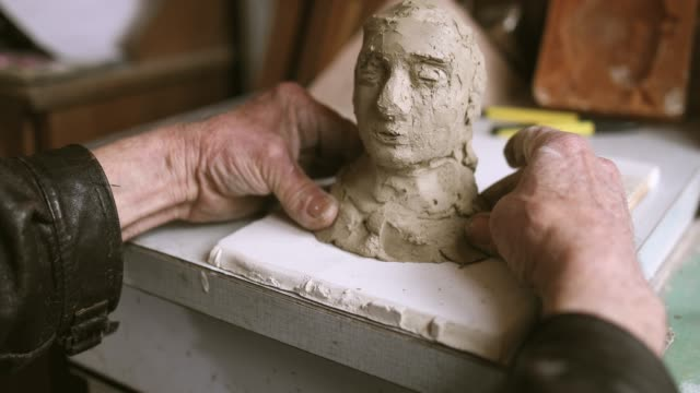 active senior making statue of clay - sculpture stock videos & royalty-free footage