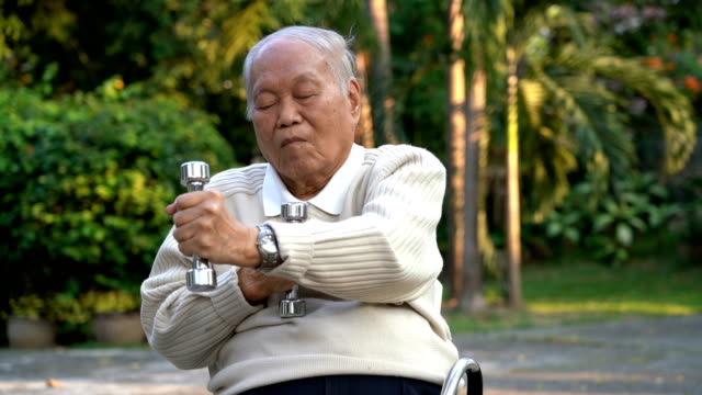 active senior man exercising with dumbbell at home - wrist stock videos & royalty-free footage