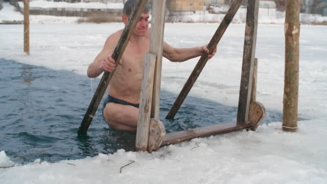 active senior man practicing cold water therapy - ice bucket stock videos and b-roll footage