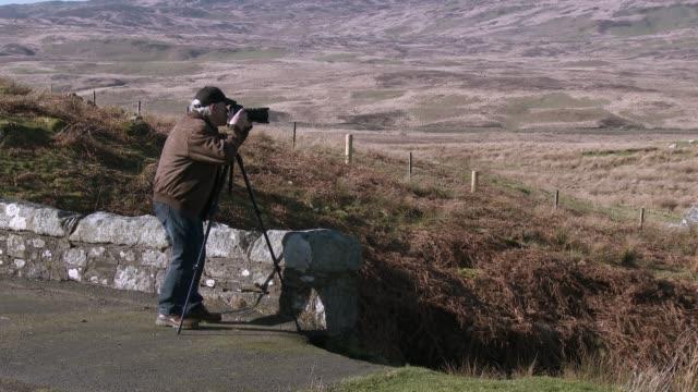 Active senior man taking photographs