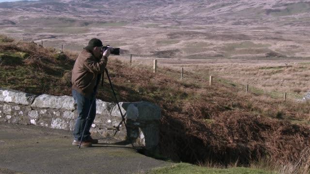 Aktiver leitender Mann fotografiert