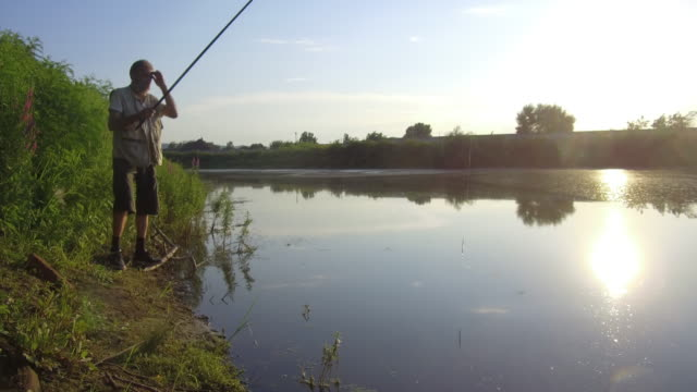 active senior man - fishing rod stock videos & royalty-free footage