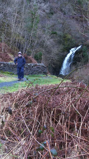 active senior man walking away from a waterfall - johnfscott stock videos & royalty-free footage