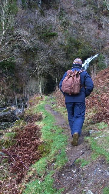 active senior man walking in a rural setting - johnfscott stock videos & royalty-free footage