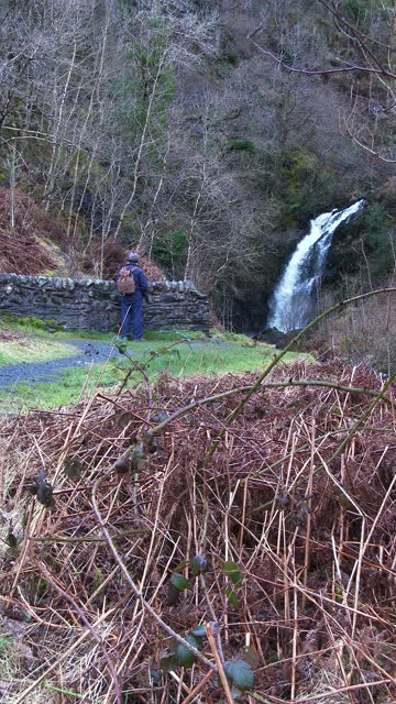 active senior man walking towards a waterfall - johnfscott stock videos & royalty-free footage