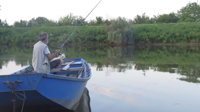 active senior man,slow motion - fishing rod stock videos & royalty-free footage