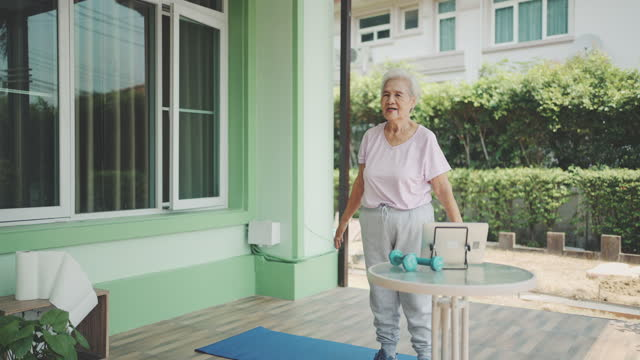 active senior woman exercising at home - health technology stock videos & royalty-free footage