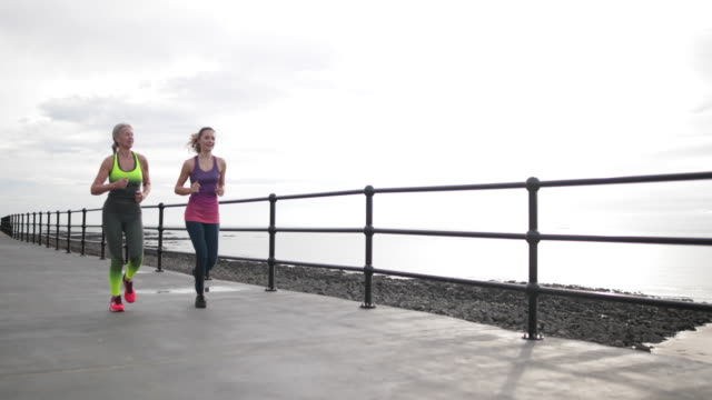 active senior woman running with daughter - kent england stock videos & royalty-free footage