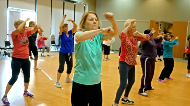Active senior women have fun in dance class