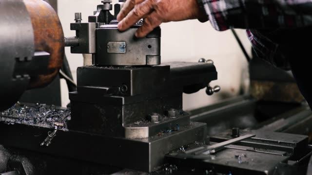Active senior working in workshop