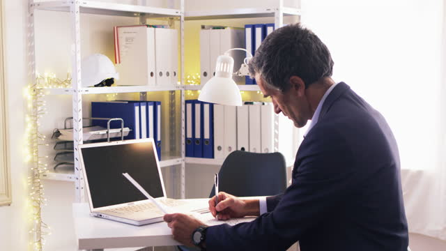 active seniors at work career. businessman working alone in his office. handsome architect preparing his project for the client during covid-19 pandemic. flatten the curve. - working seniors stock videos & royalty-free footage