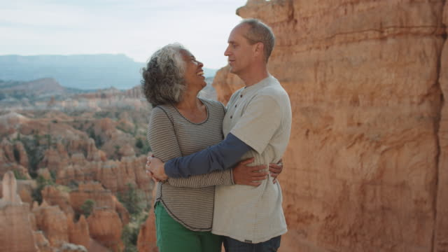 4k uhd: active seniors embracing in bryce canyon - bryce canyon stock videos & royalty-free footage